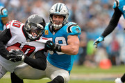 Thomas Davis #58 of the Carolina Panthers tackles Derrick Coleman #40 of the Atlanta Falcons in the third quarter during their game at Bank of America Stadium on November 5, 2017 in Charlotte, North Carolina.
