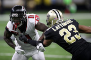Marshon Lattimore #23 of the New Orleans Saints defends  Julio Jones #11 of the Atlanta Falcons at Mercedes-Benz Superdome on December 24, 2017 in New Orleans, Louisiana.