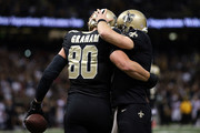Jimmy Graham #80 of the New Orleans Saints celebrates with Drew Brees #9 following a fourth quarter touchdown against the Atlanta Falcons at the Mercedes-Benz Superdome on December 21, 2014 in New Orleans, Louisiana.