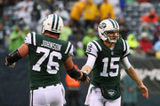 Quarterback Josh McCown #15 of the New York Jets celebrates with teammate center Wesley Johnson #76 against the Atlanta Falcons in the first quarter of the game at MetLife Stadium on October 29, 2017 in East Rutherford, New Jersey.