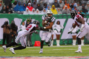 running back Matt Forte #22 of the New York Jets runs the ball against strong safety Keanu Neal #22 of the Atlanta Falcons during the first half of the game at MetLife Stadium on October 29, 2017 in East Rutherford, New Jersey.