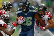 Running back C.J. Spiller #28 of the Seattle Seahawks rushes against Eric Weems #14 of the Atlanta Falcons at CenturyLink Field on October 16, 2016 in Seattle, Washington.