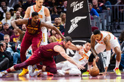 Kevin Love #0 of the Cleveland Cavaliers fights with Jeremy Lin #7 and Kent Bazemore #24 of the Atlanta Hawks for a loose ball during the first half at Quicken Loans Arena on October 21, 2018 in Cleveland, Ohio. NOTE TO USER: User expressly acknowledges and agrees that, by downloading and/or using this photograph, user is consenting to the terms and conditions of the Getty Images License Agreement.