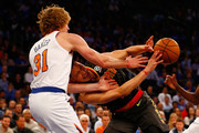 Jeremy Lin #7 of the Atlanta Hawks and Ron Baker #31 of the New York Knicks battle for the ball at Madison Square Garden on October 17, 2018 in New York City.