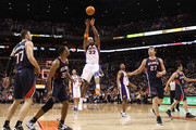Michael Redd #22 of the Phoenix Suns attempts a shot against the Atlanta Hawks during the NBA game at US Airways Center on February 15, 2012 in Phoenix, Arizona. The Hawks defeated the Suns 101-99. NOTE TO USER: User expressly acknowledges and agrees that, by downloading and or using this photograph, User is consenting to the terms and conditions of the Getty Images License Agreement.