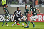 Carlos Cesar #19 of Atletico MG and Santos #21 of Palmeiras battle for the ball during a match between Atletico MG and Palmeiras as part of Brasileirao Series A 2016 at Independencia stadium on November 17, 2016 in Belo Horizonte, Brazil.