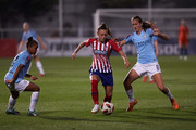 Carmen Menayo  (L) of Atletico de Madrid competes for the ball with Jill Scott (R) of Manchester City during the UEFA Women Champions League Round of 32, first leg between Atletico de Madrid and Manchester City at Wanda Sports City on September 13, 2018 in Majadahonda, Spain.