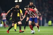 Maxime Gonalons of AS Roma tackles Fernando Torres of Atletico Madrid during the UEFA Champions League group C match between Atletico Madrid and AS Roma at Wanda Metropolitano on November 22, 2017 in Madrid, Spain.