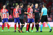 Aaron Ramsey of Arsenal and Diego Godin of Atletico Madrid argue with the referee during the UEFA Europa League Semi Final second leg match between Atletico Madrid  and Arsenal FC at Estadio Wanda Metropolitano on May 3, 2018 in Madrid, Spain.