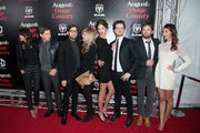 (L-R) Johanna Bennett, Matthew Followill, Nathan Followill, Jessie Baylin, Martha Patterson, Jared Followill, Caleb Followill and Lily Aldridge attend the 'August: Osage County' premiere at Ziegfeld Theater on December 12, 2013 in New York City.