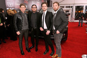 (L-R) Matthew Followill, Nathan Folllowill, Jared Followill and Caleb Followill of Kings of Leon attend 'August: Osage County' New York Ciity premiere sponsored by Ram at Ziegfeld Theatre on December 12, 2013 in New York City.