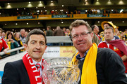 Former Lions player Robert Jones and former Wallaby Nick Farr-Jones hold the Tom Richards Cup prior to the First Test match between the Australian Wallabies and the British & Irish Lions at Suncorp Stadium on June 22, 2013 in Brisbane, Australia.