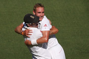 Stuart Broad (R) of England celebrates his dismissal of Ryan Harris of Australia with Kevin Pietersen during day two of the Fourth Ashes Test Match between Australia and England at Melbourne Cricket Ground on December 27, 2013 in Melbourne, Australia.