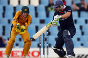 Tim Paine looks on as Luke Wright of England hits out during The 1st ICC Champions Trophy Semi Final between England and Auustralia at Supersport Park on October 2, 2009 in Centurion, South Africa.