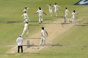 Australia celebrate after Pat Cummins of Australia claimed the final wicket of Chris Woakes of England to claim victory during day five of the Third Test match during the 2017/18 Ashes Series between Australia and England at WACA on December 18, 2017 in Perth, Australia.