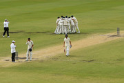 Ausralia celebrate after Pat Cummins of Australia claimed the final wicket of Chris Woakes of England to claim victory during day five of the Third Test match during the 2017/18 Ashes Series between Australia and England at WACA on December 18, 2017 in Perth, Australia.