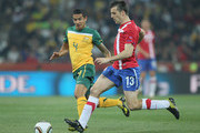 Tim Cahill of Australia and Aleksandar Lukovic of Serbia battle for the ball during the 2010 FIFA World Cup South Africa Group D match between Australia and Serbia at Mbombela Stadium on June 23, 2010 in Nelspruit, South Africa.