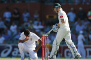 Michael Clarke of Australia looks on after hitting Imran Tahir (L) of South Africa for a boundary during day one of the 2nd Test match between Australia and South Africa at Adelaide Oval on November 22, 2012 in Adelaide, Australia.