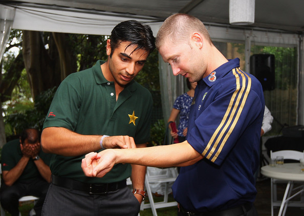 Salman Butt of Pakistan inspects Michael Clarke of Australia's tattoo during