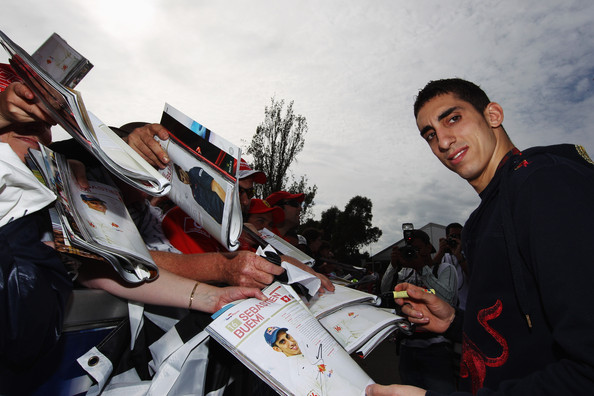 Sebastien Buemi of Switzerland and Scuderia Toro Rosso signs autographs for fans before qualifying for the Australian Formula One Grand Prix at the Albert Park Circuit on March 27, 2010 in Melbourne, Australia.
