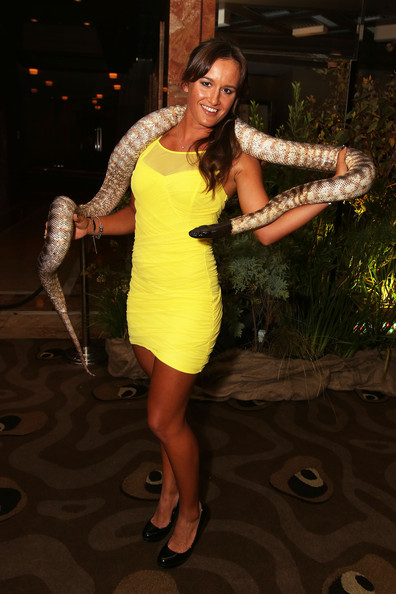 Arina Rodionova poses with a snake as she arrives at the official Australian Open player party at the Grand Hyatt on January 11, 2013 in Melbourne, Australia.