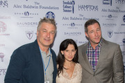 (L-R) Alec Baldwin, Hilaria Baldwin, and Ed Burns attend Authors Night for the East Hampton Library on August 8, 2015 in East Hampton, New York.