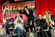 (L-R) Actor Elizabeth Olsen, President of Marvel Studios and Producer Kevin Feige, actors Josh Brolin, Mark Ruffalo, Robert Downey Jr., Tom Hiddleston, Director Joe Russo, and actors Zoe Saldana and Sebastian Stan attend the Global Press Conference at the Avengers: Infinity War Press Junket in Los Angeles, CA April 22nd, 2018