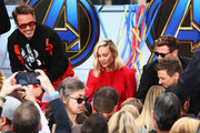 (L-R) Robert Downey Jr., Brie Larson, Chris Hemsworth and Jeremy Renner attend Avengers Universe Unites, a charity event to celebrate the donation of more than $5 million in cash and toys to nonprofits supporting children with critical illnesses, at Disney California Adventure Park on April 5, 2019 in Anaheim, California.
