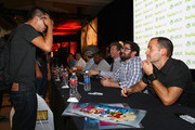 "(L-R) Guest with executive producers Seth Meyers and Michael Shoemaker, actors Ike Barinholtz, Taran Killam, Kenan Thompson, Josh Meyers, Bobby Moynihan and writer Judd Winick attend ""The Awesomes"" Comic-Con Autograph Signing at Manchester Grand Hyatt on July 20, 2013 in San Diego, California."