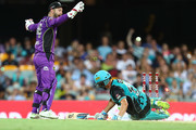 Alex Ross of the Heat is run out during the Big Bash League match between the Brisbane Heat and the Hobart Hurricanes at The Gabba on January 10, 2018 in Brisbane, Australia.