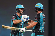 Brisbane players Alex Ross and Joe Burns celebrate winning the game during the Big Bash League match between the Brisbane Heat and the Sydney Thunder at The Gabba on December 27, 2017 in Brisbane, Australia.