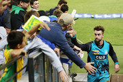 Alex Ross of the Heat signs autographs for fans during the Big Bash League match between the Melbourne Stars and the Brisbane Heat at Melbourne Cricket Ground on January 2, 2018 in Melbourne, Australia.