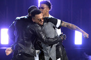 Singers Trey Songz, Chris Brown and August Alsina perform onstage during the BET AWARDS '14 at Nokia Theatre L.A. LIVE on June 29, 2014 in Los Angeles, California.