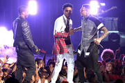 (L-R) Singers Trey Songz, August Alsina, and Chris Brown perform onstage during the BET AWARDS '14 at Nokia Theatre L.A. LIVE on June 29, 2014 in Los Angeles, California.