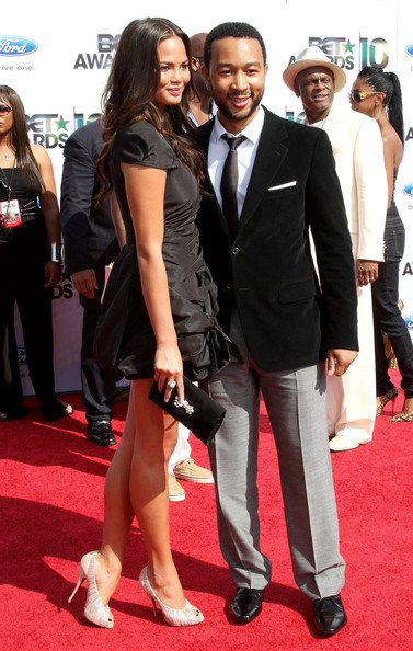 Musician John Legend (R) and Christine Teigen arrive at the 2010 BET Awards held at the Shrine Auditorium on June 27, 2010 in Los Angeles, California.