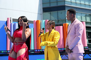 (L-R) Megan Thee Stallion, Karrueche Tran, and Terrence J are seen onstage during the Pre Show at the 2019 BET Awards at Microsoft Theater on June 23, 2019 in Los Angeles, California.