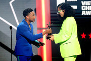 (L-R) Jacob Latimore presents the Coca-Cola Viewers' Choice Award to Ella Mai for 'Trip' onstage at the 2019 BET Awards at Microsoft Theater on June 23, 2019 in Los Angeles, California.