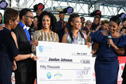 Jaeden Johnson (2nd from L) receives a check from (3rd from R-R)Simone Missick, MC Lyte, and President of Hip Hop Sisters Foundation Lynn Richardson during the 2017 Soul Train Awards Pre-Show, presented by BET, at the Orleans Arena on November 5, 2017 in Las Vegas, Nevada.