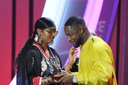 H.E.R. (L) accepts the award for Best R&B/Soul Female Artist from Tank onstage during the 2019 Soul Train Awards presented by BET at the Orleans Arena on November 17, 2019 in Las Vegas, Nevada.