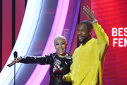 Keyshia Cole (L) and Tank present an award onstage during the 2019 Soul Train Awards presented by BET at the Orleans Arena on November 17, 2019 in Las Vegas, Nevada.