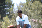 Reggie Theus tees off during BETX Golf at Wilshire Country Club on June 24, 2016 in Los Angeles, California.