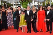 """(FromL) British screenwriter Lucy Dahl, British actress Rebecca Hall, British composer Claire van Kampen, British actor Mark Rylance, US actress Ruby Barnhill, US director Steven Spielberg, US actress Kate Capshaw, US producer Kathleen Kennedy and US producer Frank Marshall pose on May 14, 2016 as they arrive for the screening of the film """"The BFG"""" at the 69th Cannes Film Festival in Cannes, southern France.  / AFP / LOIC VENANCE"""