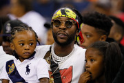 Rapper 2Chainz looks on during week eight of the BIG3 three on three basketball league at Infinite Energy Arena on August 10, 2018 in Duluth, Georgia.