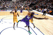 Reggie Evans #30 of 3 Headed Monsters loses the ball against C.J. Leslie #5 and Will Bynum #3 of Bivouac during week four of the BIG3 three-on-three basketball league at Barclays Center on July 14, 2019 in the Brooklyn borough of New York City.