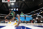 Julian Wright #30 of the Power dives for a loose ball against Larry Sanders #8 of the 3 Headed Monsters during week nine of the BIG3 three on three basketball league at American Airlines Center on August 17, 2019 in Dallas, Texas.