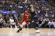 Al Harrington #3 of Trilogy drives into Carlos Boozer #5 of the Ghost Ballers during the BIG3 three on three basketball league at Scotiabank Arena on July 27, 2018 in Toronto, Canada.