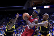 Mike James #13 of Tri-State drives to the basket between Reggie Evans #30 and Chauncey Billups #1 of the Killer 3s during week three of the BIG3 three on three basketball league at BOK Center on July 9, 2017 in Tulsa, Oklahoma.
