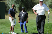 Woody Paige (R) watches his tee shot on the 12th hole along with teammate Chauncey Billups (L) during the Gardner Heidrick Pro-Am ahead of the BMW Championship at the Cherry Hills Country Club on September 3, 2014 in Cherry Hills Village, Colorado. Paige and Billups were teamed with Ernie Els of South Africa.