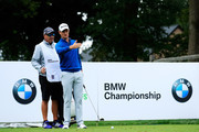 Justin Rose of England talks with his caddie Mark Fulcher on the fifth tee during the third round of the BMW Championship at Aronimink Golf Club on September 8, 2018 in Newtown Square, Pennsylvania.