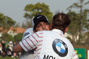 Francesco Molinari of Italy and his caddie Jason Hempelman embrace on the 18th hole during the final round of the BMW Masters at Lake Malaren Golf Club on October 27, 2013 in Shanghai, China.